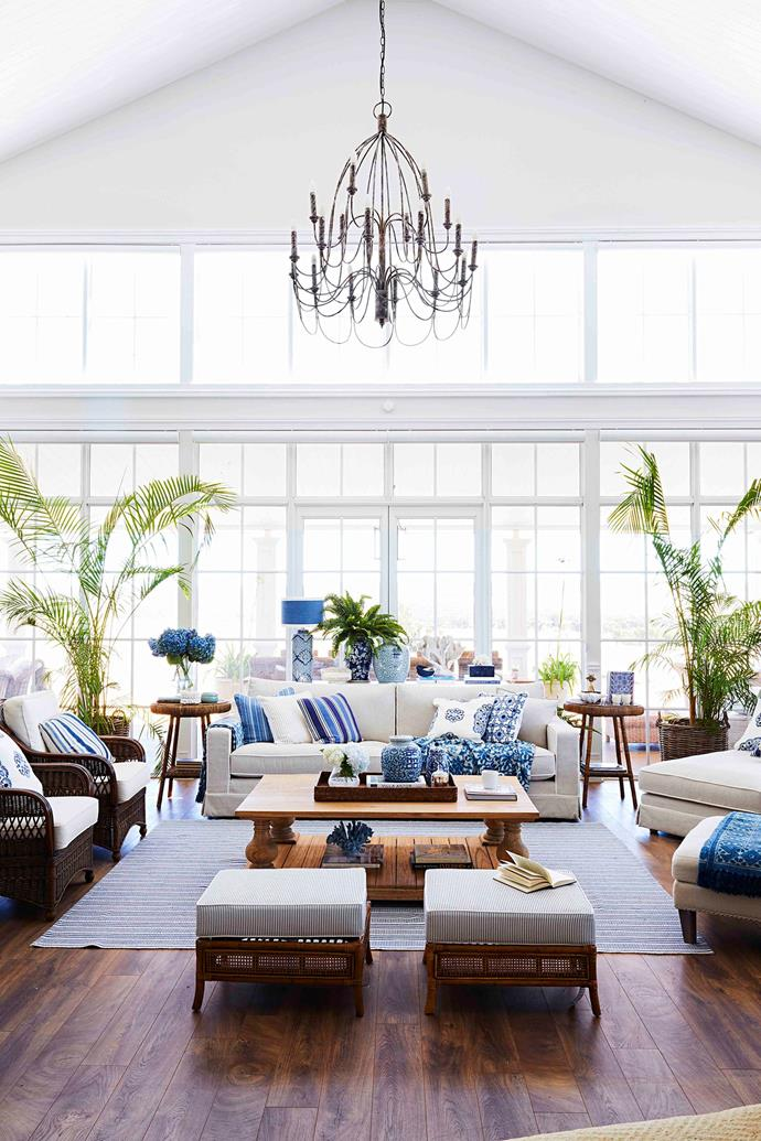 In the main living area, a soaring eight-metre-high ceiling and wall of French doors and transom windows, by Jason Windows, floods the room with natural light. The crowning glory is a one-metre-wide chandelier from One World.