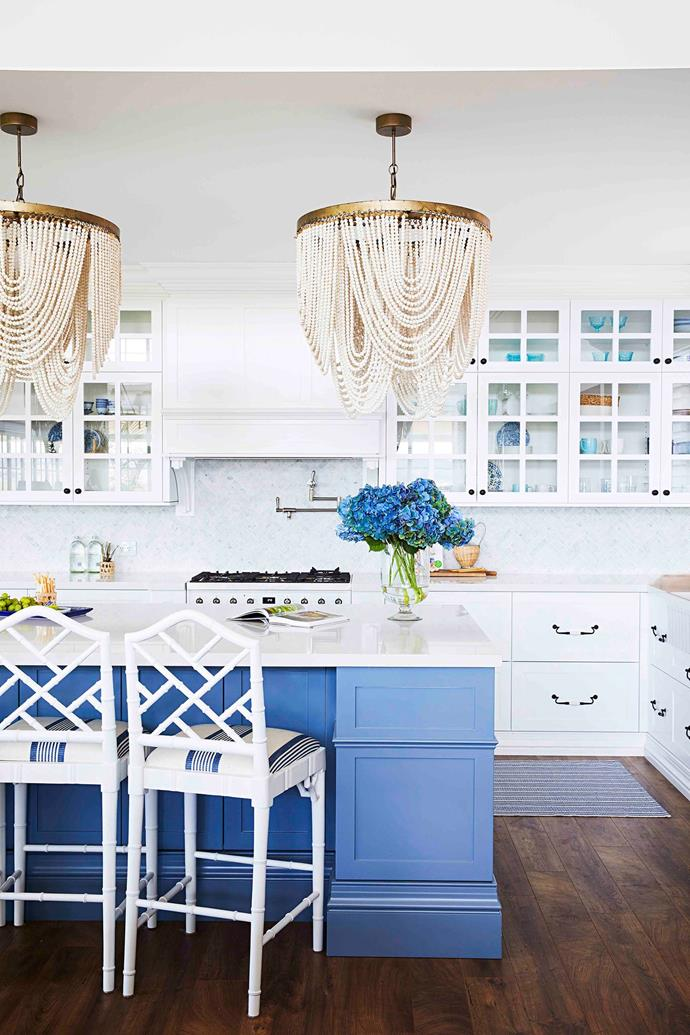 """Keen to create something different rather than """"cookie cutter"""", the couple's starting point for the kitchen design was a trio of bespoke timber-beaded chandeliers, available through Indah Island."""