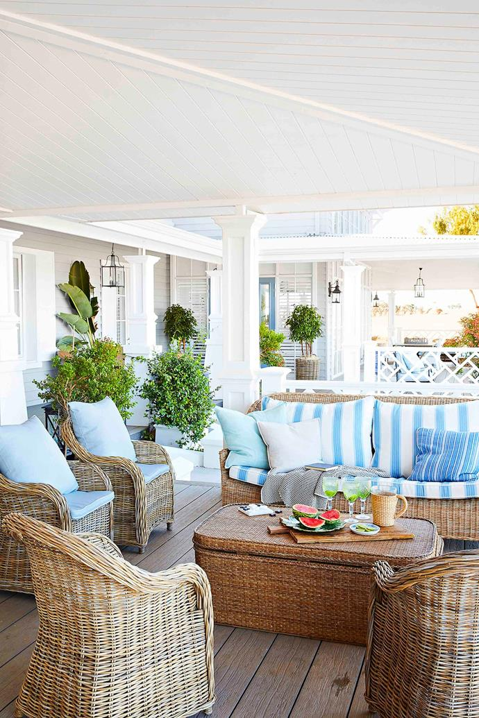 In keeping with the resort-like feel, comfort is still key outside, where an array of plump wicker chairs and sofas are clustered for casual entertaining.
