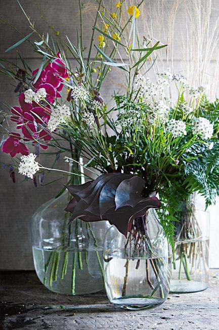 **Trio of vases**: There's a reason why this classic combination is so enduring: it just always works! Divide your flowers into three separate arrangements and pop into simple glass vases. Choose vases of different heights and widths to create visual interest.