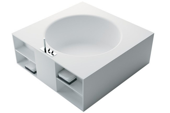 **Baths |** The circular bath with a handy storage unit save space in small rooms. The 'Inout' tub for [Agape](http://www.agapedesign.it) can also be installed as a corner element with wall-mounted taps.