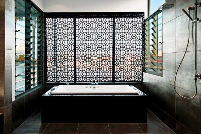 Baths | The beauty of the Moroccan-inspired detailing behind this bath delivers in more ways than one. It is actually a roman blind. Designer Eileen Middleton used a [Zimmer+Rohde](http://www.zimmer-rohde.com/) fabric that diffuses light and is also private. The [CaesarStone](http://www.caesarstone.com.au/) bath surround in Espresso createa a feeling of intimacy and grandeur.