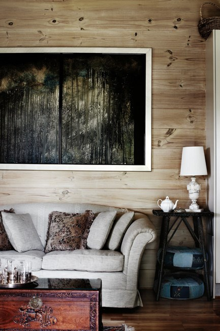 _The Gully_, Greg's painting of bush in the NSW Blue Mountains, hangs in a sitting room.  Words and styling: Pia Jane Bijkerk | Photo: Sharyn Cairns