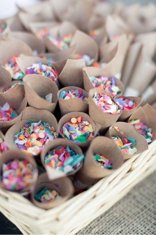2\. Colourful paper confetti wrapped in matte brown kraft paper cones. You can't beat a classic! Image from [Chickabug Blog](http://blog.chickabug.com/).