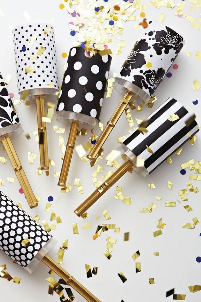 3\. Gold confetti party poppers are ideal for creating a fun and festive vibe. Image from [Colin Cowie Weddings](http://www.colincowieweddings.com/).