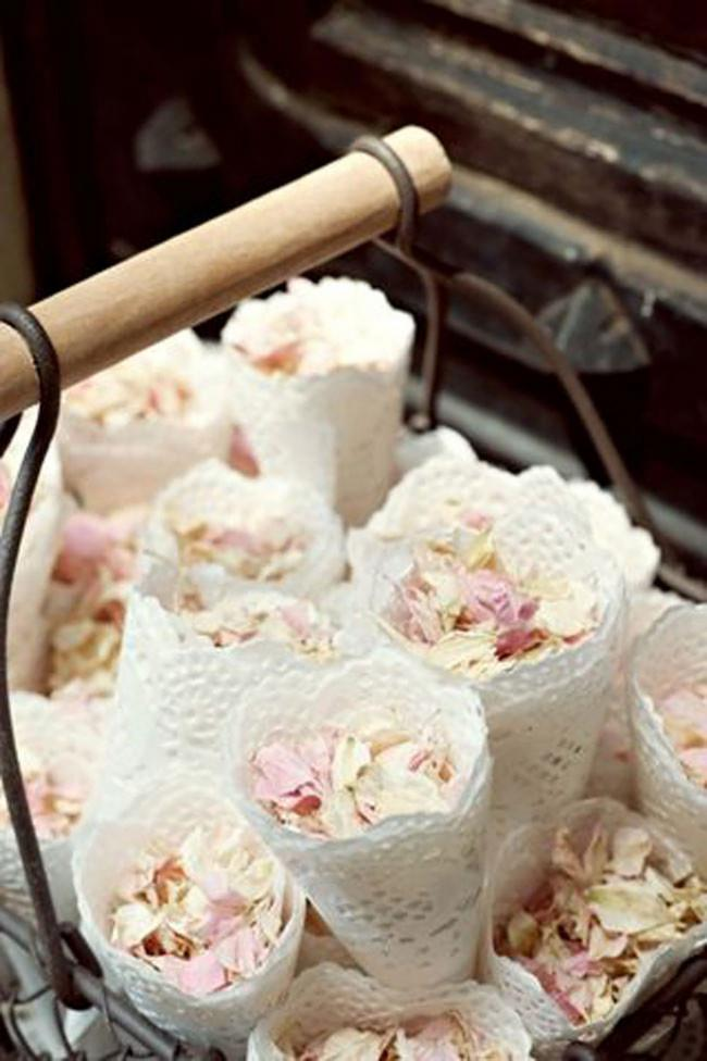 8\. Pastel rose petals wrapped in doily cones offer an elegant touch. Image from [French Wedding Style](http://www.frenchweddingstyle.com/).