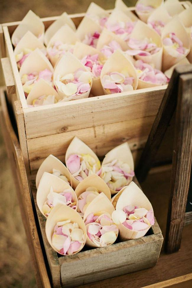 13\. Pastel petals in sturdy bamboo cones are a sturdy option for handing out to guests. Image from [Ruffled Blog](http://ruffledblog.com/).