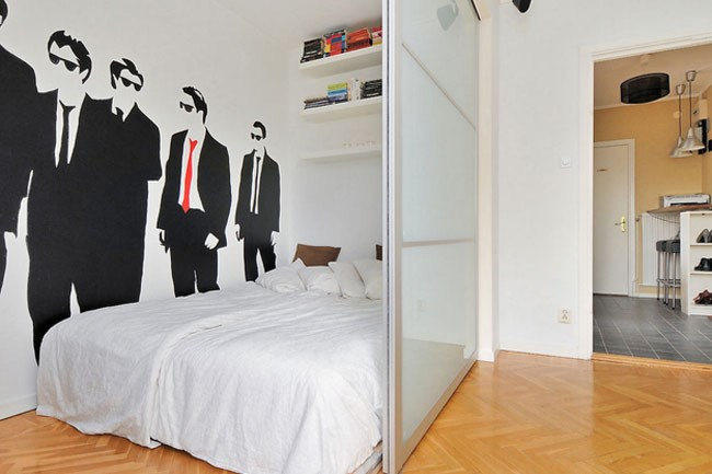 Partition made from Ikea Pax sliding cupboard doors, image from [Ikea Hackers](http://www.ikeahackers.net/2010/10/turn-your-studio-apartment-into-1.html)