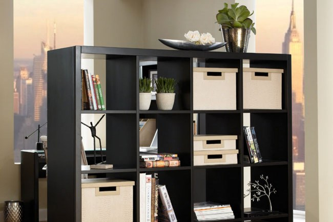 The trusty [Ikea Kallax shelving unit](http://www.ikea.com/au/en/catalog/products/40275870/#/00275867) used as a space divider.  [Click here for more room divider ideas.](http://www.homelife.com.au/decorating/storage/room+divider+ideas,3696)