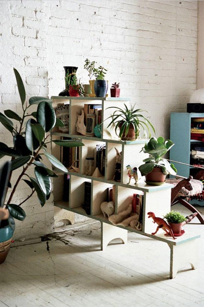 Bookshelf as a room divider, image from [Smart Chicks Commune](http://smartchickscommune.tumblr.com/post/34355917153)