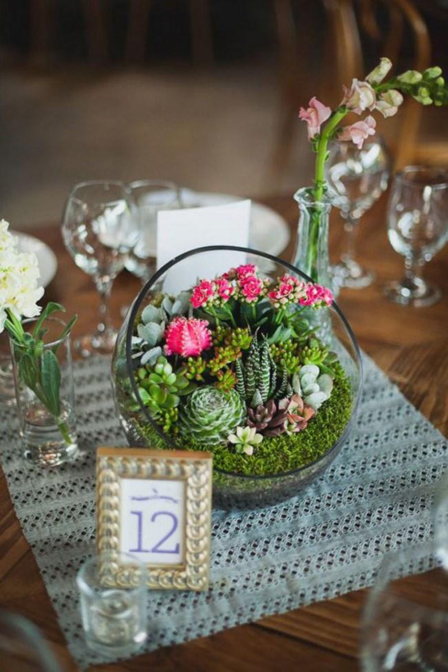 Combine cacti, succulents and moss for an eye-catching terrarium. _Image via [Wedding Chicks Blog](http://www.weddingchicks.com/)_