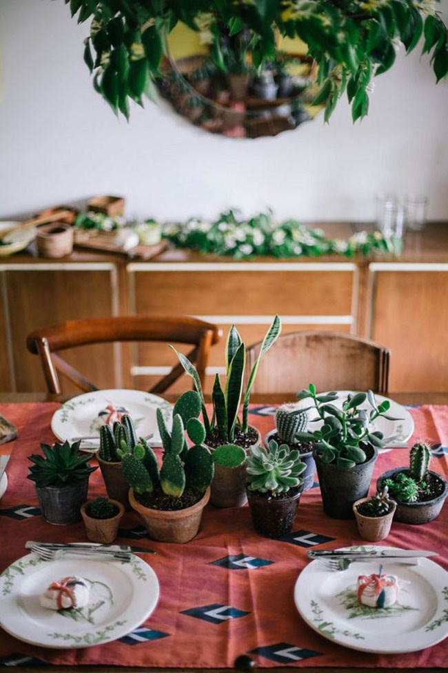 Mix cacti, succulents and mother-in-laws tongue in different sized pots for a cool, low-key table setting. _Image via [Sycamore Street Press](http://www.sycamorestreetpress.com/)_
