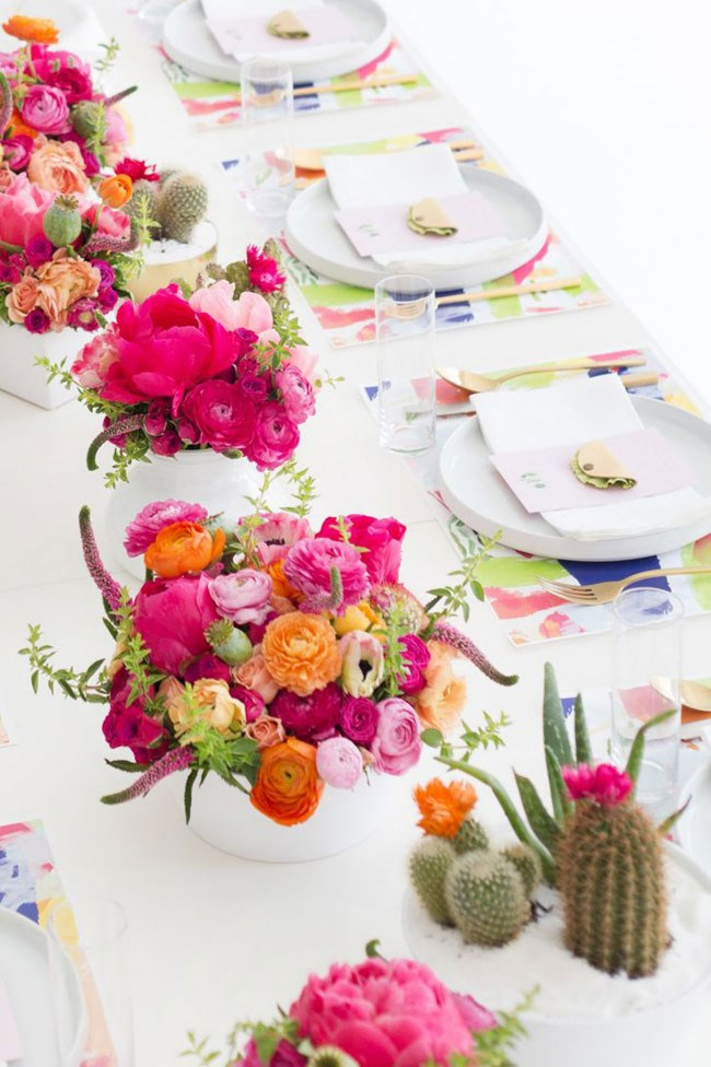 Vivid fiesta colours look stunning next to crisp, white table linen and cacti in bloom. _Image via [Studio DIY](http://www.studiodiy.com/)_