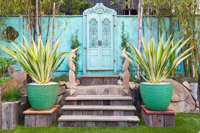 Landscape designer and owner of[The Small Garden](http://www.thesmallgarden.com.au/), Tom Brooks, talks us through his 10 favourite residential projects.  **1\. Bohemian entrance door.** In this small courtyard, a large exotic door was sourced and installed into the copper painted fence. The wooden stairs and pot plinths are made from reclaimed railway sleepers. Bright green dimpled pots with strappy architectural plants add interest and balance to the space.
