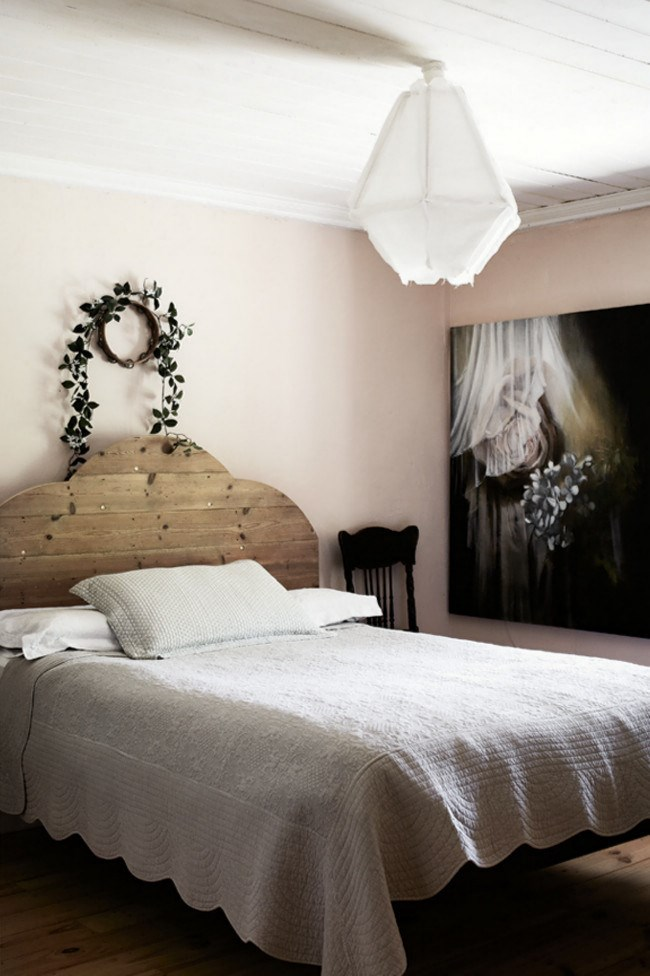 This warm cottage bedroom is a celebration of [handcrafted](http://www.homelife.com.au/homes/homewares/how+to+make+lovebird+pillows+with+silk+flowers+,7961) objects where a finely worked bedspread offsets the raw beauty of a simple timber bed frame. A wreath of leaves on the wall, an ethereal light and a whimsical painting instil a dreamy charm.