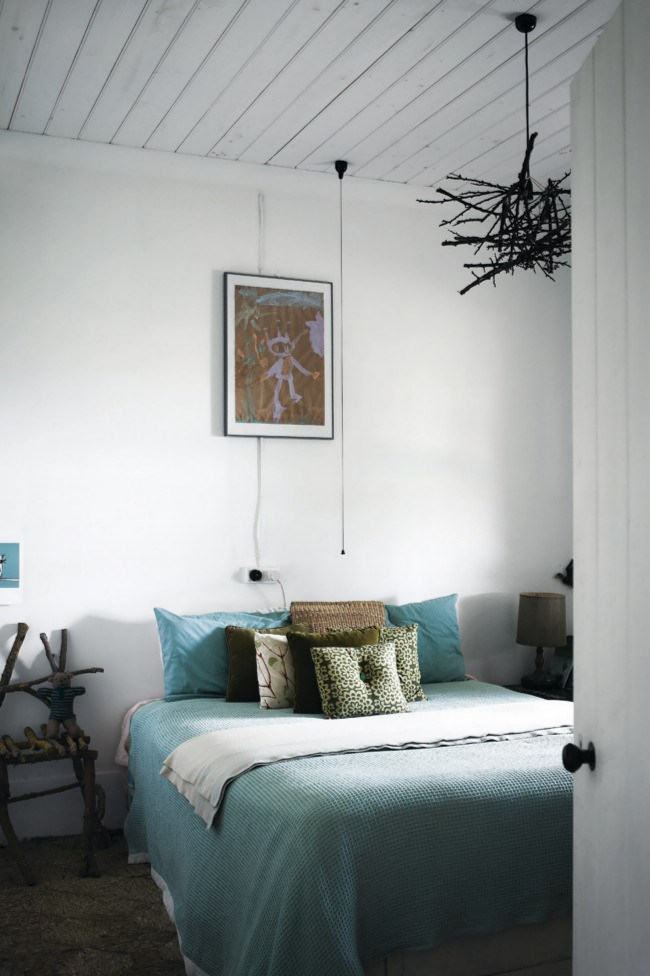 A love of nature comes to the fore in this bedroom where a creative owner crafted a sculptural [light](http://www.homelife.com.au/homes/galleries/lighting,14135?pos=6) fitting and chair from garden prunings. Mossy greens and earthy browns feature in the [bedding and cushions](http://www.homedecorators.com/).
