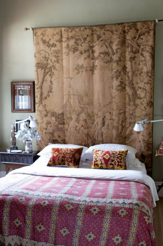 In a harmony of contrast, an early 20th-centry Belgian tapestry forms a captivating backdrop in this bedroom while a brightly patterned antique Indian bedspread and colourful silk velvet [cushions](http://www.homelife.com.au/decorating/trends/how+to+make+a+scarf+cushion,4243) enliven the space.