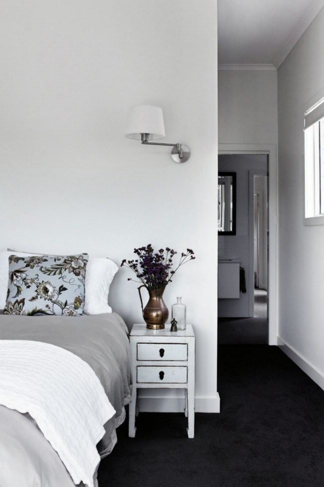 Neutral hues and a cushion covered in [Warwick Fabric](http://www.warwick.com.au/)'s 'Zepher' create a serene environment in the bedroom.