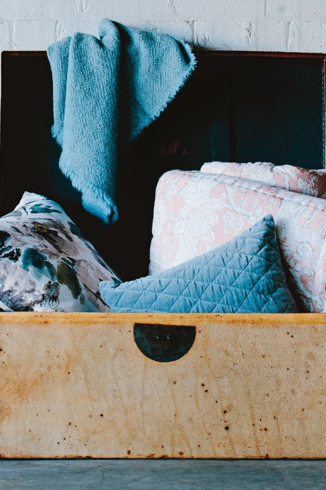 Look for decorative storage ideas for your quilts, rugs and pillows — a vintage chest, a French armoire, or an open-topped storage basket. Look for ways to put beautiful items on display, rather than tucked away in a cupboard.