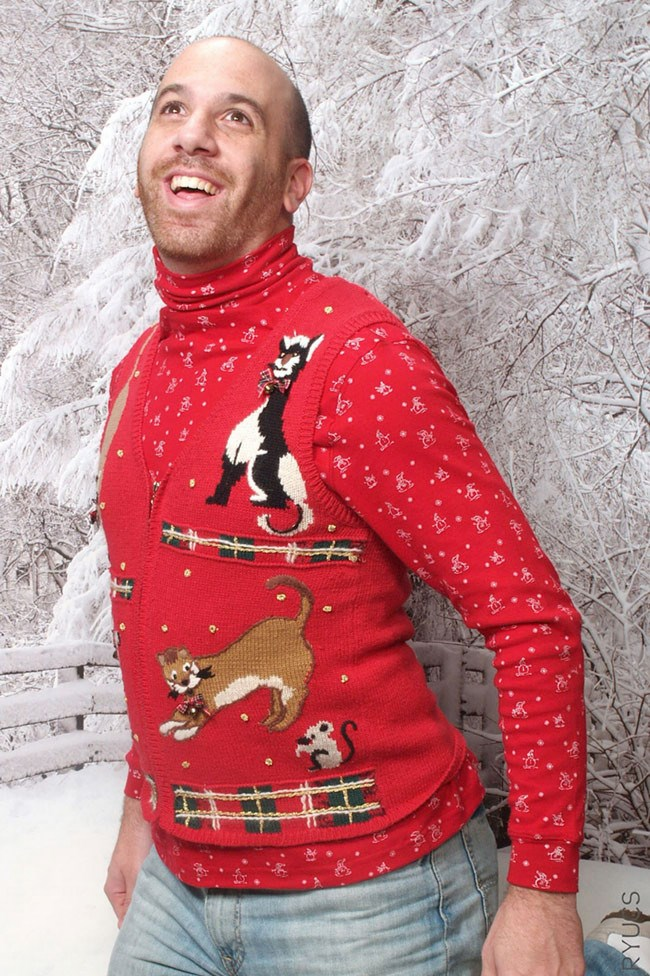 And now, the civilian category. Although with this majestic Christmas jumper pose, we can't understand why this guy's not famous. _Image from [Rock Your Ugly Christmas Sweater](http://rockyouruglychristmassweater.com/)_