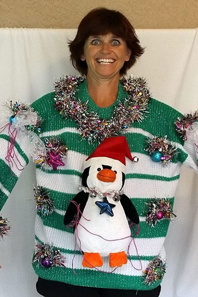 Deb's crazy eyes work beautifully with her tinsel embellishments. _Image from [Deb's Tacky Christmas Sweaters](https://www.facebook.com/DebsTackyChristmasSweaters/photos_stream?ref=page_internal)_