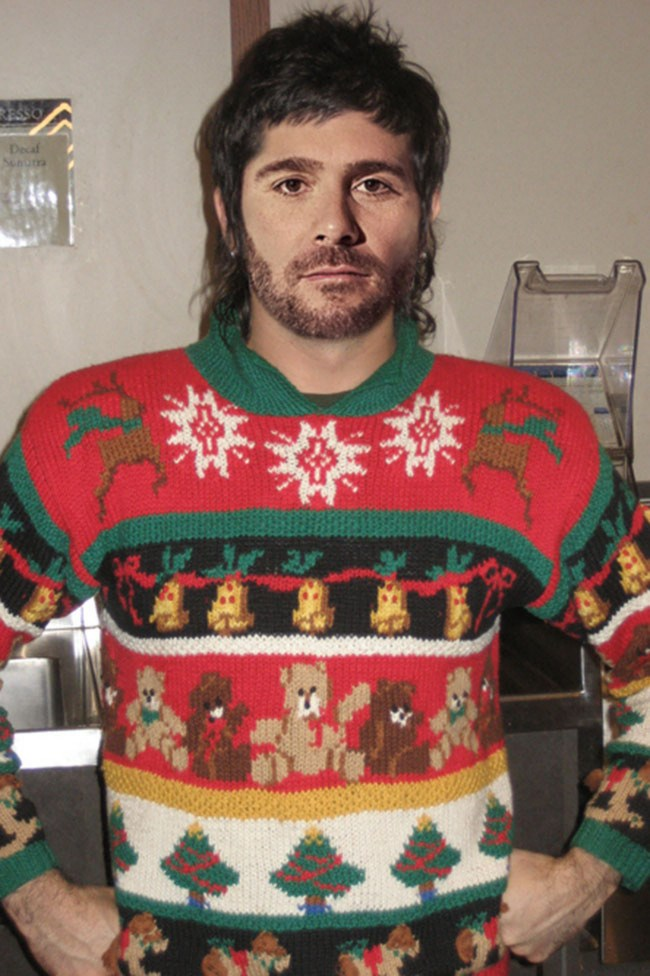 Is it a hipster? Is it the 80s? No, it's a NASCAR driver's head photoshopped onto an unidentified ugly jumper body! Time well spent. _Image from [Team Jimmy Joe](http://www.teamjimmyjoe.com/2011/12/nascar-drivers-and-their-ugly-christmas-sweaters/)_