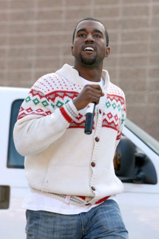 """Kanye West, the stylish rapper who wrote the lyric """"I'm Hugo's boss"""", let's his fashion guard down with a classic Christmas knit._Image from [The Daily Beast](http://www.thedailybeast.com/galleries/2011/11/28/celebrities-in-ugly-christmas-sweaters-photos.html#0ea5815c-c656-478a-b186-f6395ecf0cda)_"""