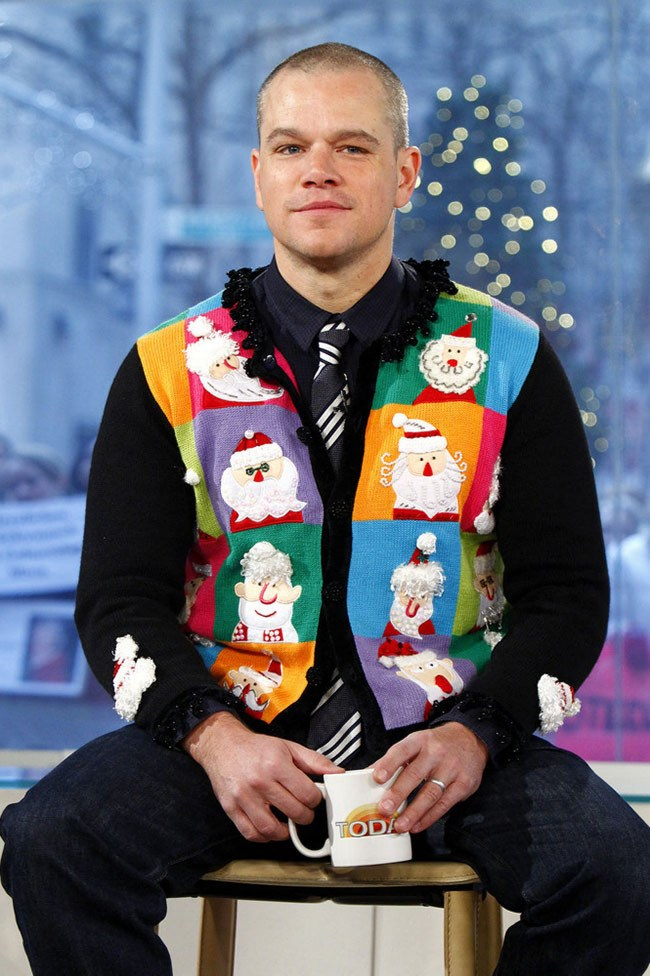 Acclaimed actor Matt Damonin a multi-coloured, many-faces-of-Santa faux vest._Image from [Fashion & Style](http://www.fashionnstyle.com/articles/37323/20141225/top-10-celebrity-ugly-christmas-sweaters.htm)_