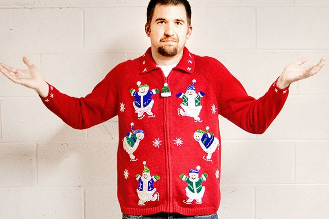 This guy's pretending not to love his bedazzled ice skating snowmen Christmas jumper. But you can see the ecstatic truth in his eyes. _Available from [The Ugly Sweater Shop](http://theuglysweatershop.com/?attachment_id=5806)_