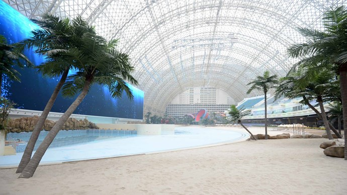 Phoenix Seagaia Resort, Japan. The world's largest indoor swimming pool features artificial waves, real sand and a 'sky' painted with clouds. The air temperature is constantly a balmy 30 degrees Celsius.