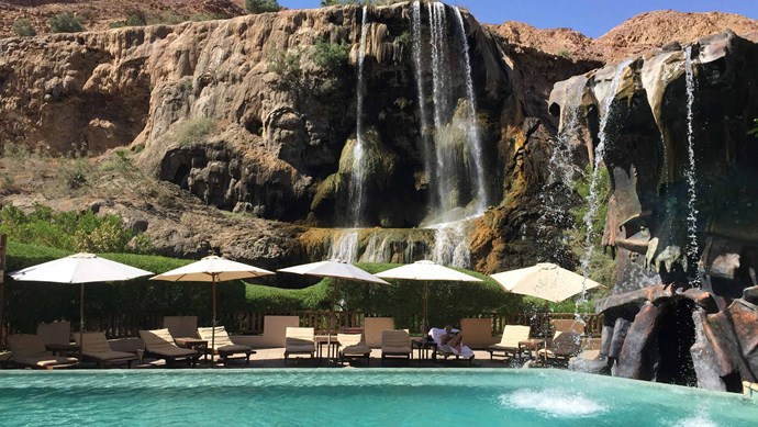 Six Senses, Jordan, Middle East. Relax beneath a natural hot spring waterfall that cascades into the pool.