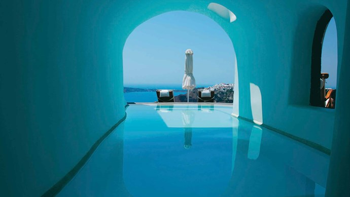 Perivolas, Greece. This five star hotel is carved into the side of a cliff overlooking the Aegean Sea, complete with sun loungers and an infinity pool.