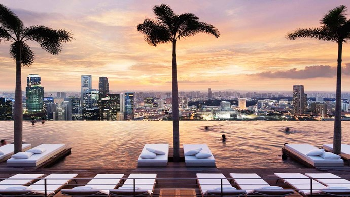 Marina Bay Sands, Singapore. Take an exhilarating dip in the world's highest infinity pool set against the vibrant backdrop of downtown Singapore.