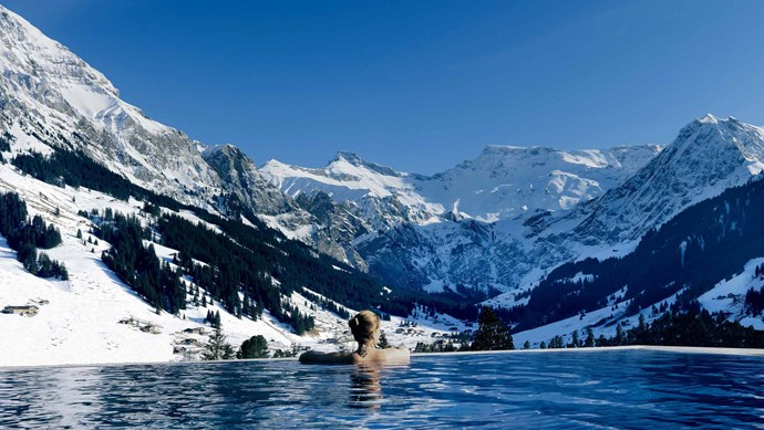 The Cambrian, Swiss Alps. Tired of skiing and snowboarding? Head to the heated pool to soothe your muscles and take in the spectacular view of snow-capped Swiss mountains.