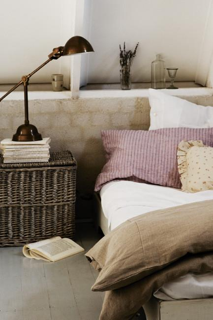 This rattan laundry hamper has been re-purposed to become a [bedside table](http://www.homelife.com.au/homes/galleries/10+of+the+best+bedside+tables+,20689) in this French bedroom.  **Like this? Try our other DIY ideas:**  \* [French antiques](http://www.homelife.com.au/homes/galleries/french+antiques,10178)   \* [French-style garden](http://www.homelife.com.au/gardening/projects/french+style+garden,4833)   \* [Painting drawers](http://www.homelife.com.au/homes/living+dining/painting+drawers,3538)  Plus, don't miss more great ideas on [Facebook](http://www.facebook.com/homelife.com.au) and you can also find us on [Pinterest](http://pinterest.com/homelifecomau/). | Photo: Sam McAdam-Cooper