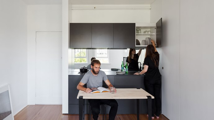Cleverly divided into two discrete spaces - public and private - the tiny apartment boasts an open-plan living area, including a kitchen, dining and living area.    Photo: Katherine Lu