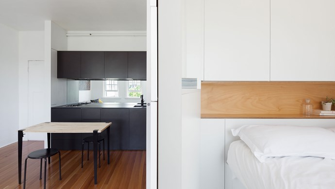The bedroom is an exercise in minimalism - there's not much in there besides the bed itself. But behind the white joinery is a wardrobe, and under the bed, there's more storage.    Photo: Katherine Lu