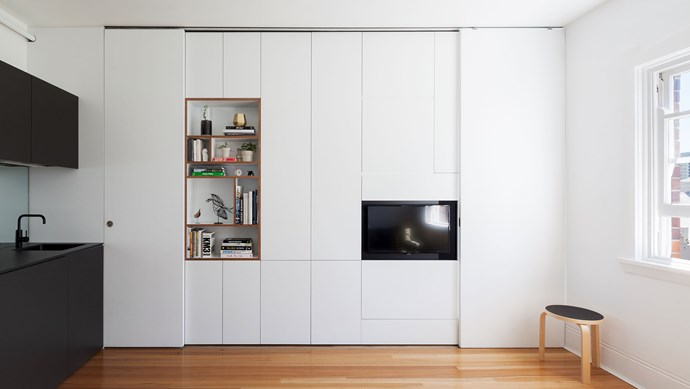 In many studios and one-bedders, it's hard to separate living and entertaining areas from the bedroom. Swartz's solution? A sliding wall that doubles as clever storage (and triples as an entertainment unit).    Photo: Katherine Lu