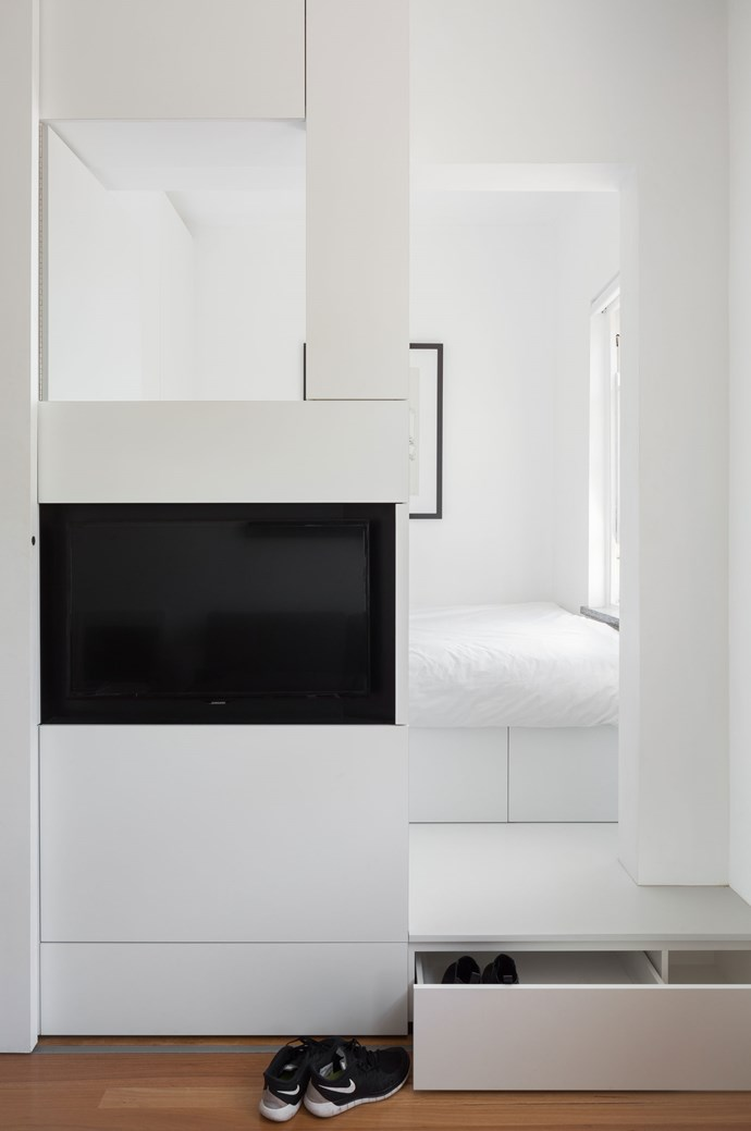 In the bedroom, the bed sits on top of a large storage box.   Photo: Katherine Lu
