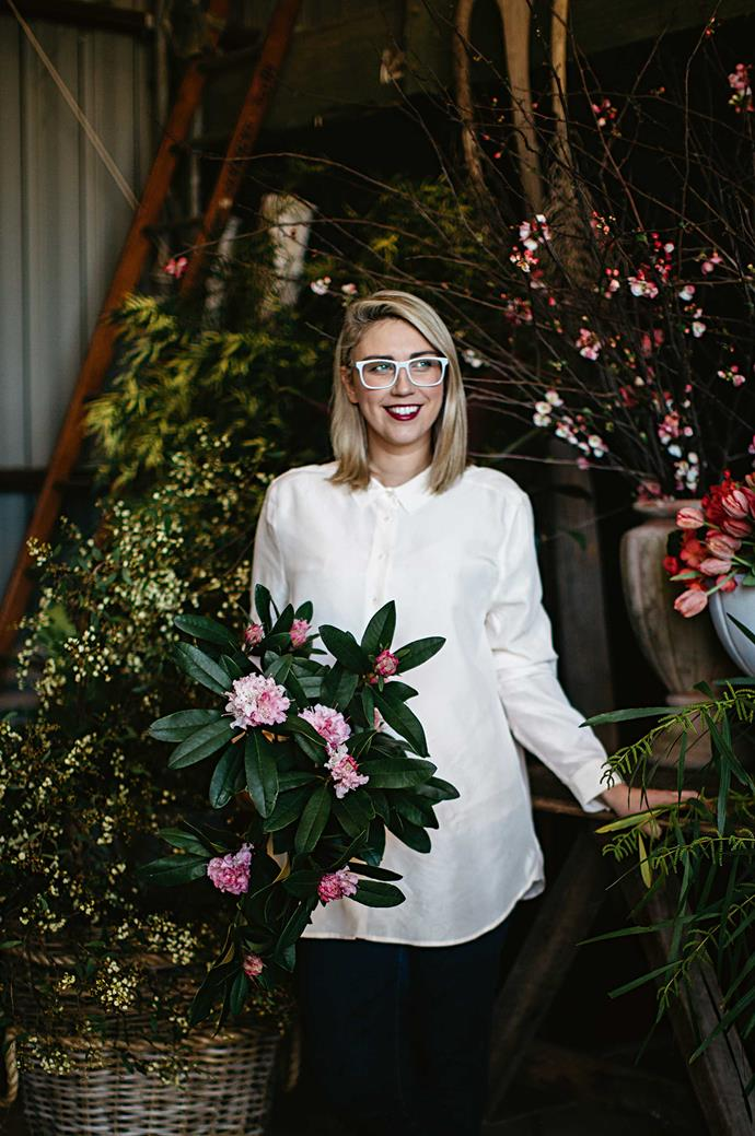 Aleksandra Keast in her workspace with rhododendrons and tulips - two of her favourite flowers.