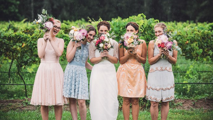 Georgia with her bridesmaids. Rain on your wedding day not only brings luck - it also creates a beautiful soft light for photographs. Flowers by Holly Hipwell. | Photo: Jac + Heath