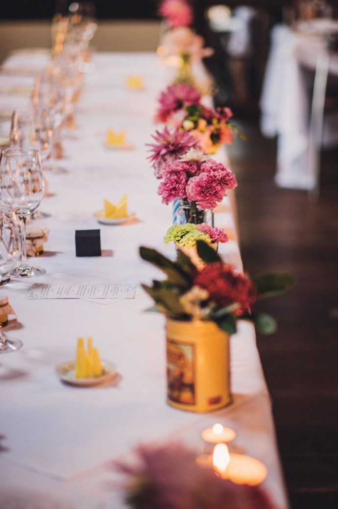 Colourful posies were arranged in vintage vessels on the restaurant tables. | Photo: Jac + Heath