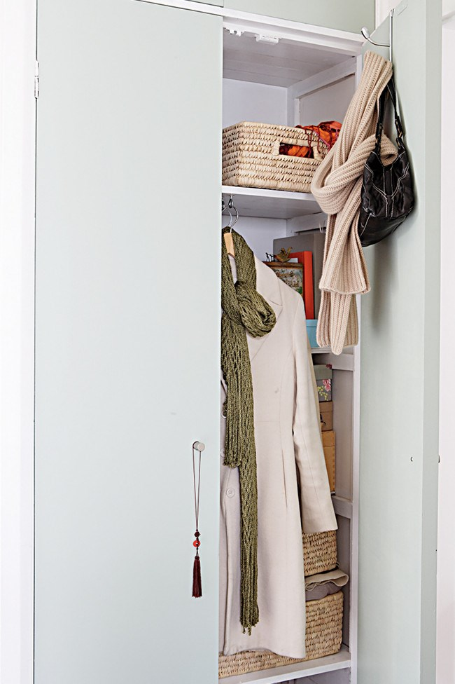 6. Built-in cupboard. Hide clothes away in a cupboard, maximising storage with over-the-door hooks.   Photo: Sam McAdam-Cooper