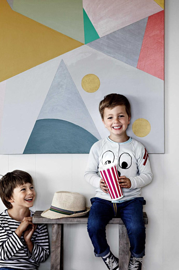 Six-year-old Luca and Arki, four, in front of a painting by their mother, Amber Phillips. | Photo: Sharyn Cairns
