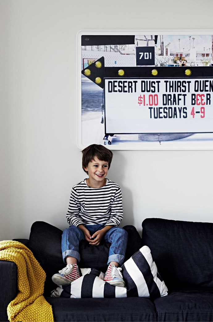 Luca in the downstairs TV room. On the wall is a photograph Amber took while in Palm Springs, California. | Photo: Sharyn Cairns
