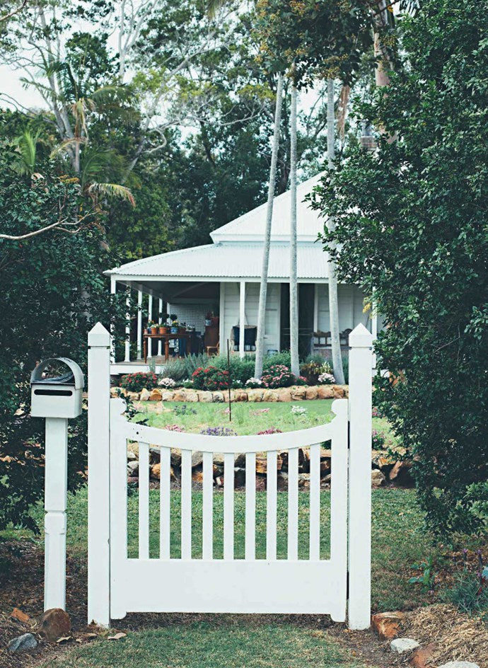 It's an 1880s open-plan timber Queenslander with wide verandahs and a large garden that's planted with poppies, astors, calendulas and cosmos among the hedges, with dahlias planned for the end of spring. | Photo: Jared Fowler