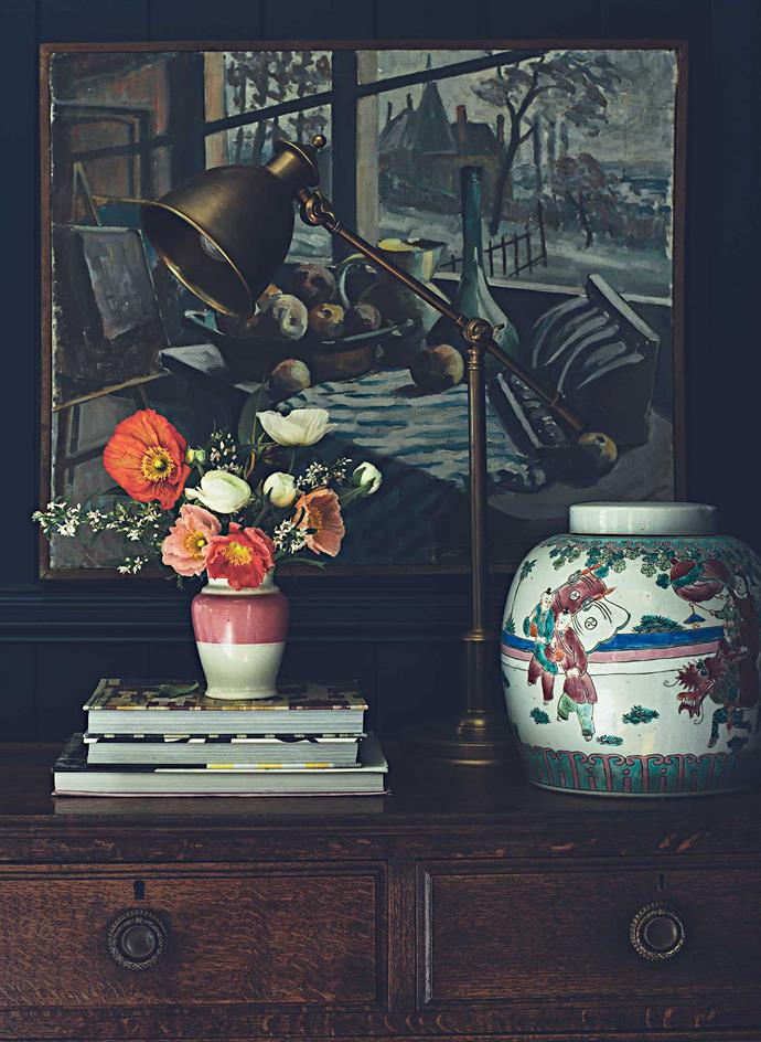 Anna's bedside table is an old chest of drawers. The small vase is a keepsake from her grandmother.