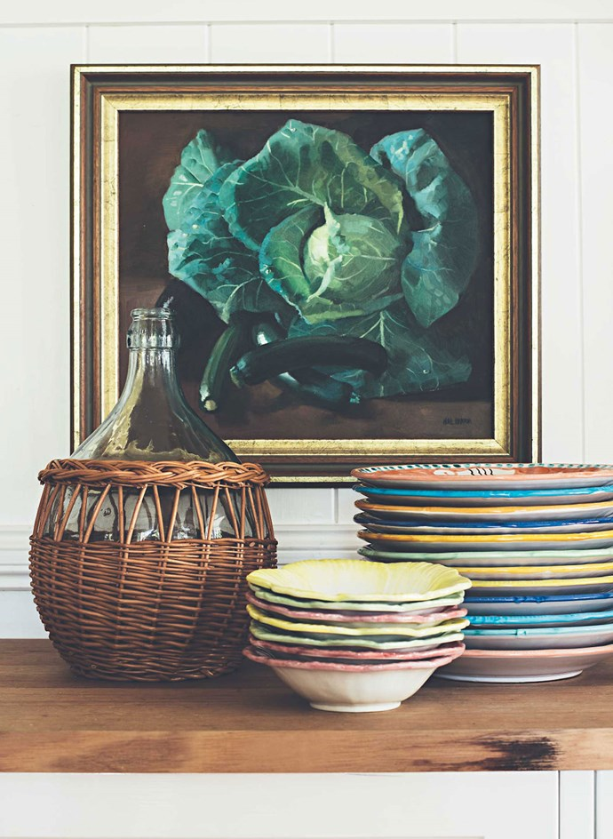 Plates and bowls from Italy beside an old French wine jug. | Photo: Jared Fowler
