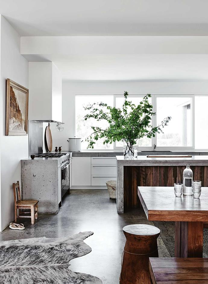 "[Concrete benches](https://www.homestolove.com.au/7-ways-to-use-concrete-in-your-home-4840|target=""_blank"") make a bold statement in the open-plan kitchen."