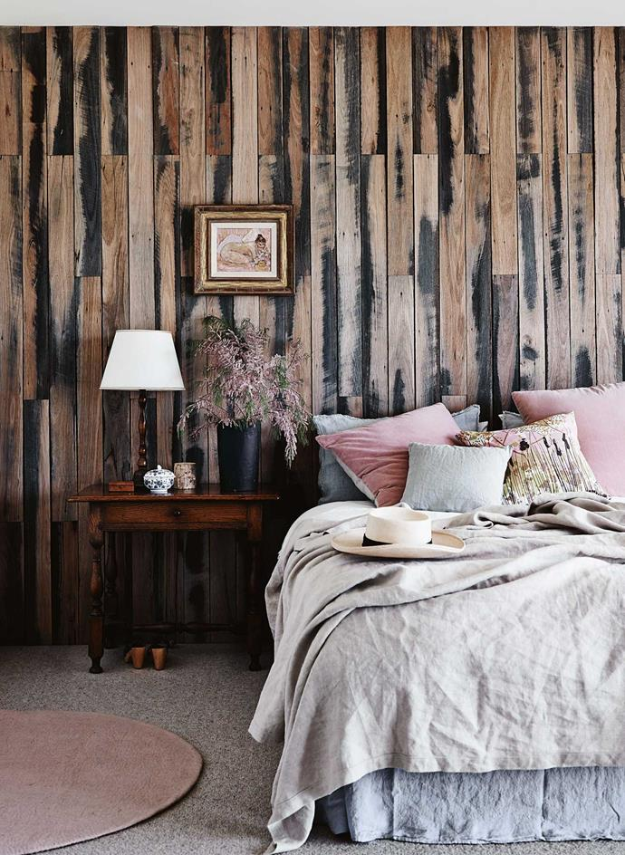 "The main [bedroom's feature wall](https://www.homestolove.com.au/master-bedroom-decorating-ideas-5494|target=""_blank"") is made from fence palings recycled from the old house."